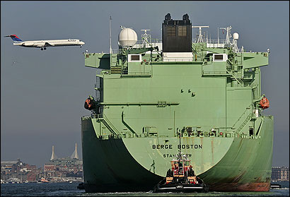 The Berge Boston, a liquefied natural gas tanker on its way to the Distrigas terminal in Everett, headed into Boston Harbor under the flight path of Logan International Airport. The weekly shipments have drawn extraordinarily tight security since the Sept. 11 terror attacks.