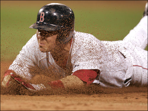 Mark Loretta slid safely back into first base during a rundown in the ninth inning.