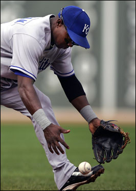 Kansas City Royals second baseman Estaban German chased after a bobbled ball on a hit by Jason Varitek in the third inning.