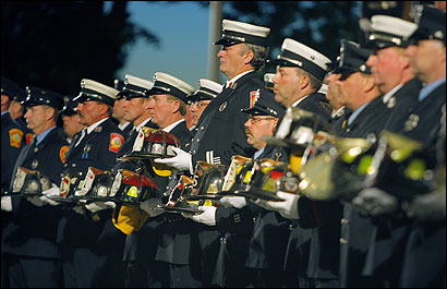 A Service of Remembrance was held yesterday on the Esplanade at sunset, as firefighters from Boston and across the state gathered to honor 343 of their New York City comrades who died five years ago. As each of the names was read, a firefighter carried a helmet representing a victim.