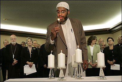 Imam Abdullah Faaruuq of the Islamic Council of New England lit a candle at an interfaith gathering.