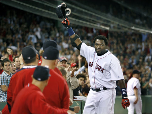 Boston Red Sox designated hitter David Ortiz is congratulated by third baseman Mike Lowell (25) after Ortiz hit a solo home run in the sixth inning of their baseball game against the Minnesota Twins at Fenway Park in Boston Wednesday night, Sept. 20, 2006. (AP Photo/Stephan Savoia)