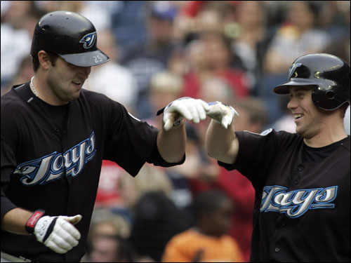 Troy Glaus, left, celebrated with Aaron Hill after Glaus hit a solo-home run during the fourth inning.