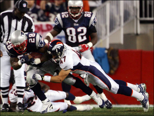 Corey Dillon took a hit from Broncos safety John Lynch in the first quarter. Dillon would leave the game with an arm injury in the first half.