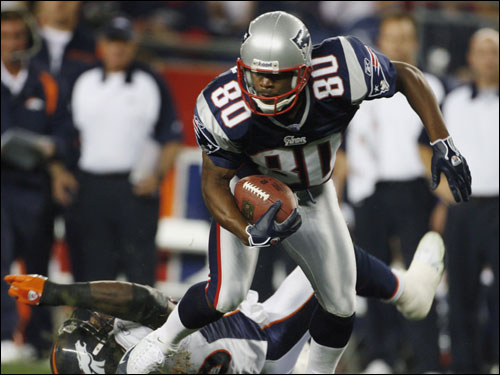 Patriots wide receiver Troy Brown left Denver defender Al Wilson in his wake after he caught a first half pass from Tom Brady.
