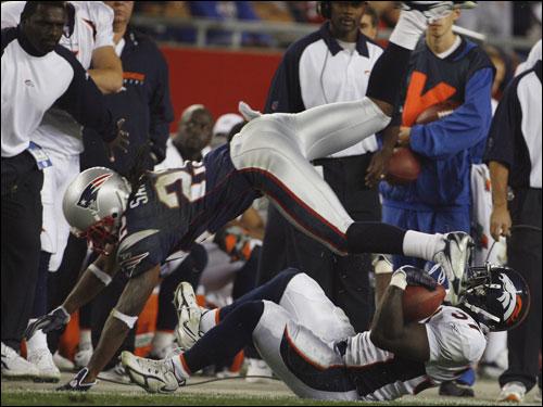 Patriots cornerback Assante Samuel sailed over the Broncos RB Cecil Sapp after a first half gain.
