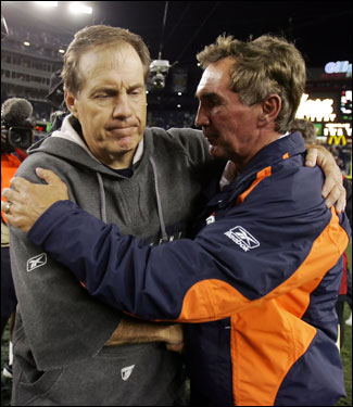 Patriots head coach Bill Belichick (left) greeted Broncos head coach Mike Shanahan after the Broncos 17-7 victory at Gillette stadium.