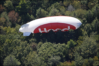 A Hood blimp crashed in the woods of Manchester-by-the-Sea yesterday after onshore winds thwarted the pilot's attempt to make an emergency landing on Singing Beach. The pilot was uninjured.