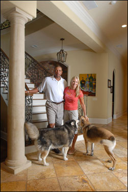 Doc and Kris with their two dogs Ellie (left) and Mickey in their home.