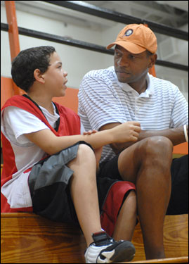 Doc chatted with his son Spencer during the volleyball game.