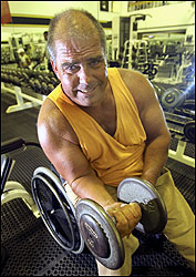 John McClay of Abington preparing for the upcoming USA Wheelchair Bodybuilding Championship.