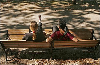 Marina Geagtiarovo (left) and Rashid Galiev, both of Brookline, sat on an unusually shaped bench, an art piece by Matthew Hincman, at Jamaica Pond in Jamaica Plain.