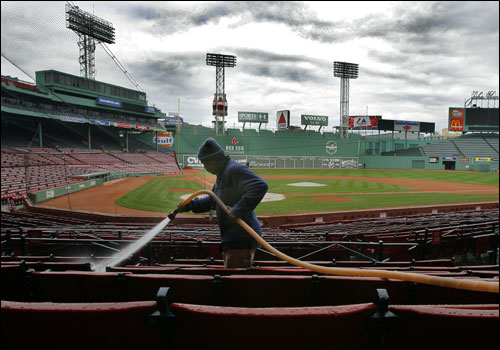 The sky was gray and there was a chill in the air as David Santiago, a team employee, washed down the seats in the empty park.