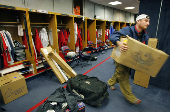 Clubhouse attendant Jared Pinkos moved a box as he and his co-workers packed up the players belongings.