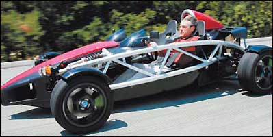 Ian Wright, founder of Wrightspeed Inc., races along the highway in Woodside, Calif., in his electric sports car.