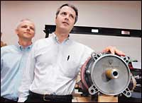 Tesla Motors' Martin Eberhard (right), chief executive, and Marc Tarpenning (left), vice president of engineering, with an electric motor.