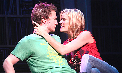 Will Chase as Rob and Jenn Colella as Laura.