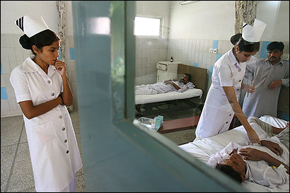 With the Christian Hospital in Sahiwal, Pakistan, running far below capacity, nurses frequently check on patients.