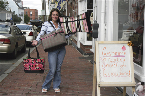 Karen Ross poses for a portrait while promoting bags from the Anna Street Studio on Market St where creating a custom bag is part of the fun.