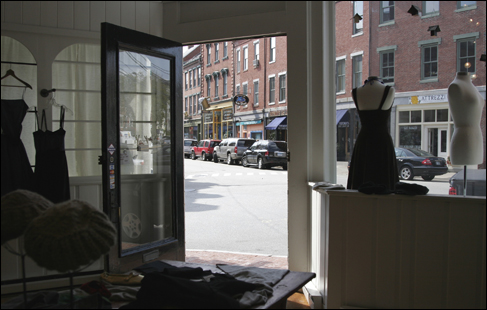 From the inside of the store called Bliss, the corner of Market and Bow Streets intersect looking outside.