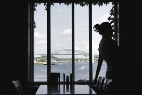 The bridge heading to Maine over the Piscataqua River is framed by a window at the Stockpot restaurant.