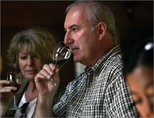 Linda and Richard Pratt sample some of the fine wines at a Greenvale Vineyard wine tasting.