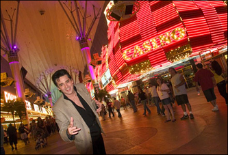 Elvis has left the building--Connolly walks through the neon in old downtown Las Vegas.