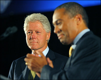 Bill Clinton (left) was on stage yesterday with the Democratic candidate for governor, Deval L. Patrick. ''I'm so proud of Deval, I could practically burst,'' the former president said.