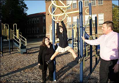 Jennifer Doyle, president of Presentation School Foundation, with husband Kelley and their daughter, Lucy, visited the playground of the former parochial school, which will be used as a community education center.
