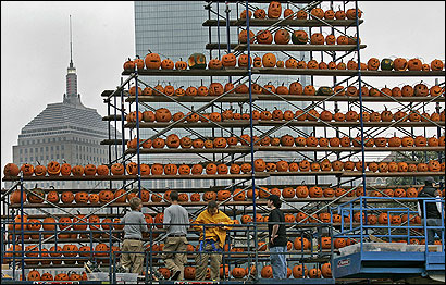 A pumpkin skyscraper gave the Boston Common a ghoulish landscape. The city hopes to set a record for the most pumpkins lit in one place.