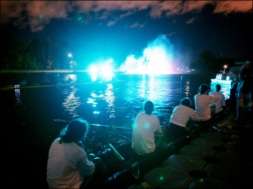 The Cambridge University women's rowing team rested and watched a light and music show after they won the women's race during a rare night race to kick off the Head of the Charles on Friday.