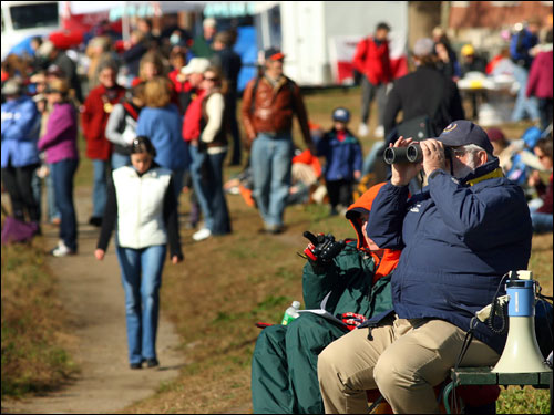 The banks of the Charle River on Memorial Drive at Western Ave. were packed with regatta watchers.