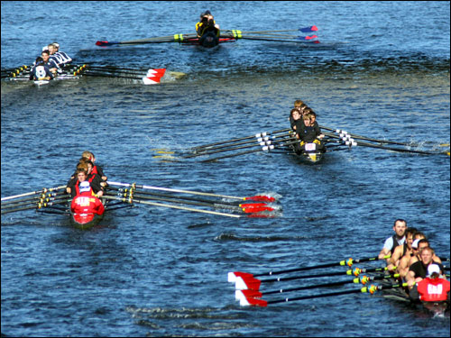 Rowers headed down the Charles in the club eights race.