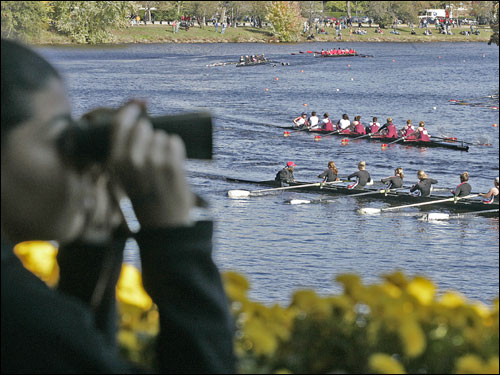 Andrea Bresnahan watched the boats from the porch of the Cambridge Boat Club during the club women's eights race.