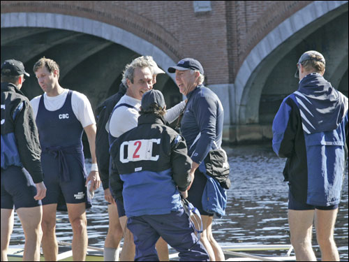 Race director Fred Schoch ( center, facing left) and his team placed first in the senior master men's eights.