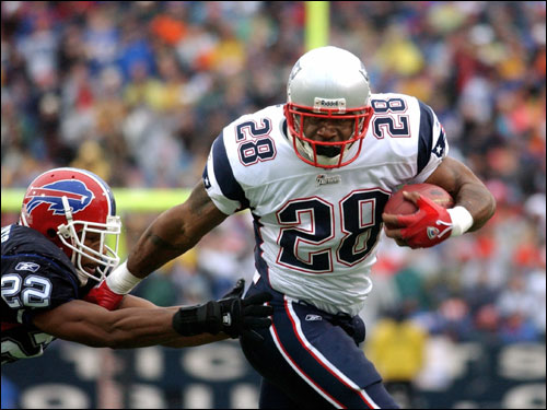 Bills cornerback Nate Clements (left) dove towards Patriots running back Corey Dillon as he scored his second touchdown.