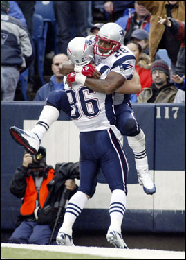 Corey Dillon and David Thomas celebrated Dillon's second touchdown of the game.