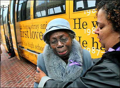Cindy Diggs of Peace Boston tried to console Emma Harrison yesterday as the Dorchester woman, whose grandson was slain at age 15 in 1998, wept at memories churned up by the memorial bus, which was unveiled at City Hall Plaza.
