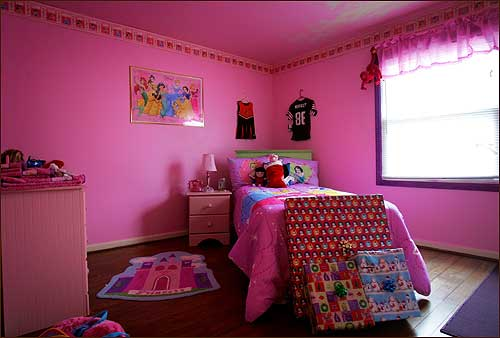 Wilson prepared this room in his townhouse apartment for his 4-year-old daughter Ayana. The Christmas presents at the foot of the bed in what he calls the 'princess room'' went unopened until late summer when Wilson resumed regular weekend visits with his daughter.