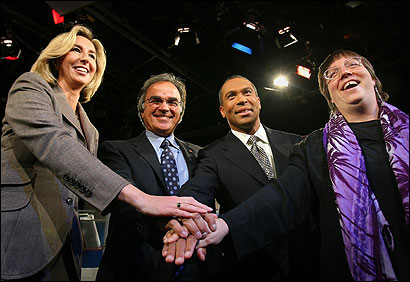 The four gubernatorial candidates — (from left) the Republican lieutenant governor, Kerry Healey; independent Christy Mihos; Democrat Deval Patrick; and Green-Rainbow Party nominee Grace Ross — joined hands before beginning last night's debate.