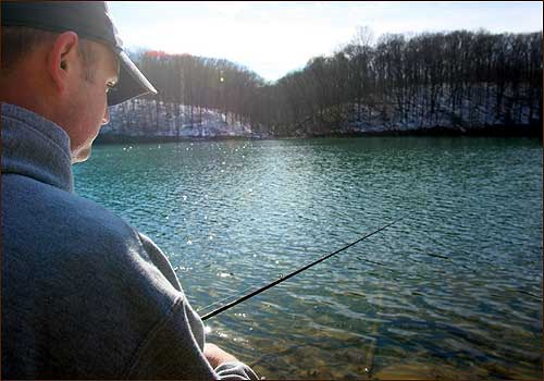 An avid outdoorsman all his life, Dustin Jolly showed his little girl, Aaliyah, the pleasures of fishing on a lake near their home in Bloomington, Ind.