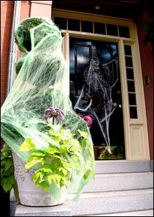 Nearby Louisburg Square, home of Senator John Kerry, is one of the most exclusive locations in Boston. Above, festive Halloween decorations spice up the front steps of a home in Louisburg Square.