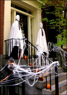 More Halloween decorations in Louisburg Square, including a pair of spooky ghosts.