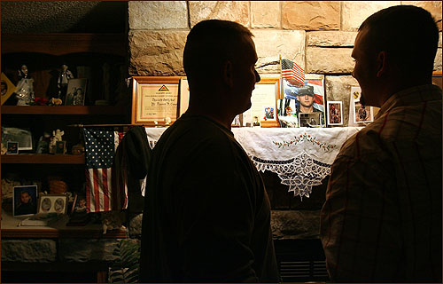 Jolly and Wilson examined some war memorabilia on the mantel of Tom Crouch, Dustin's maternal grandfather, who is a veteran of the Korean War. The survivors of Chaos 4 spent several quiet moments looking over pictures and letters.