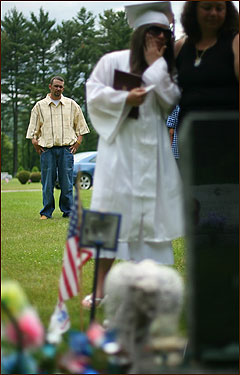 Amanda and Shawn Regnier reflected tearfully at the grave of Jeremy Regnier as Andy Wilson, Jeremy's superior officer who was with him the night he was killed, stood alone and away from the family huddle moments after Amanda's high school graduation ceremony.