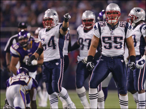 Patriots Junior Seau reacts after stopping the Vikings running back Chester Taylor
