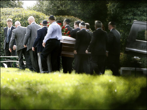 Pallbearers carried Red Auerbach's casket from a hearse to his grave at King David Cemetery in Falls Church, Va. Auerbach, who led the Boston Celtics to 16 NBA championships as either coach, general manager or club president, died Oct. 28 at the age of 89.