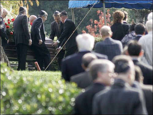 Mourners walked to the site of Red Auerbach's funeral as pallbearers carried the casket.