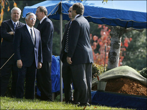 NBA commissioner David Stern (second left) stood with mourners near the tent covering Red Auerbach's grave.