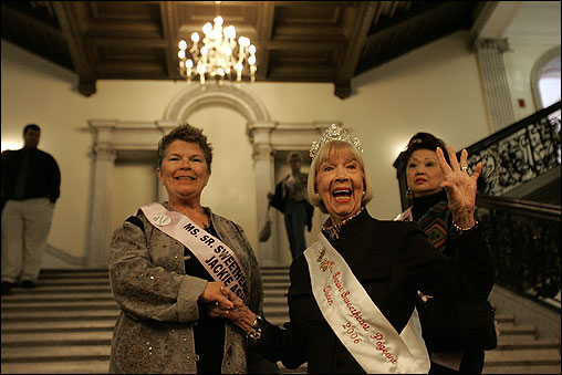 Reigning queen Virginia Ann Freeman, 86, waved on the Grand Staircase after a photo session. At left is contestant Jackie Ashley of Massachusetts.